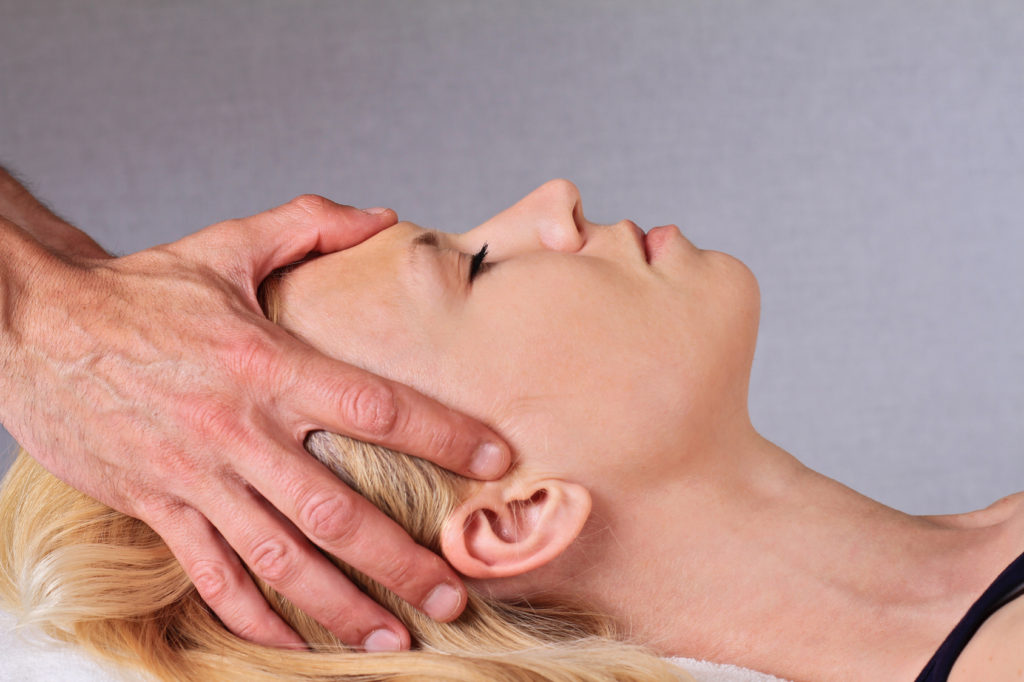 Chiropractic, osteopathy, dorsal manipulation, acupressure. Therapist doing healing treatment treatment on woman's back . Alternative medicine, pain relief concept